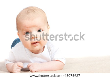cute little baby playing on the floor - isolated on white background
