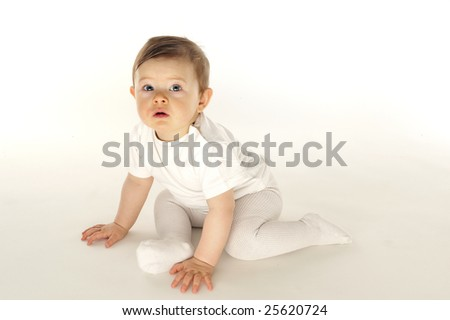 Cute little baby Sit in white field