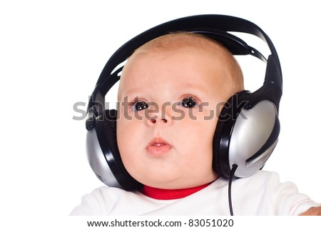 cute little baby with headphones on white