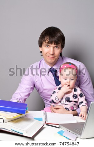 Cute little baby with her business father - stock photo