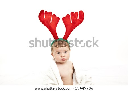 cute little baby with reindeer hat - stock photo