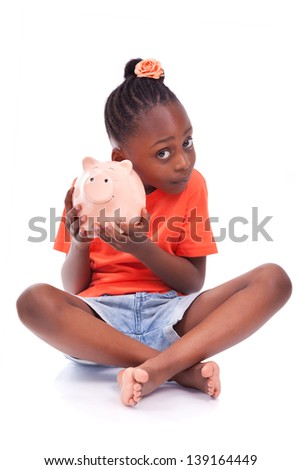 Cute little black girl holding a smiling piggy bank, isolated on white background - African children - stock photo
