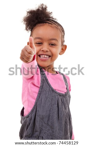 Cute little black girl making thumbs up - stock photo