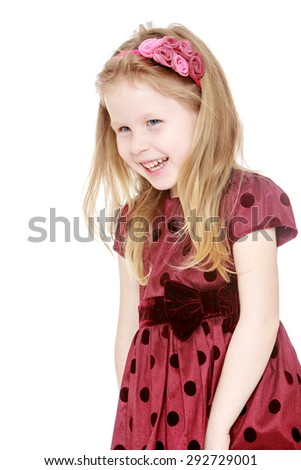 Cute little blond Caucasian girl in a fluffy dress with polka dots , close-up - isolated on white background - stock photo