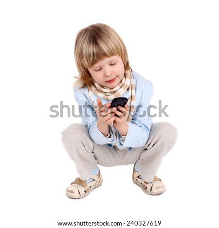 cute little blond child playing with the mobile phone