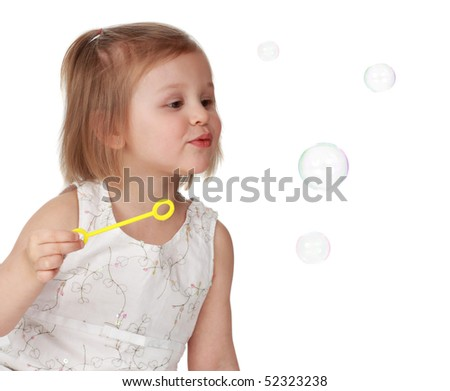 cute little blond girl looking at bubble soap