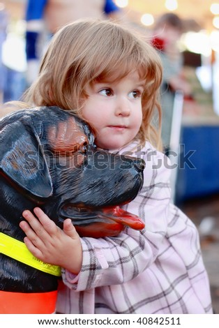 Cute little blonde girl and a dog - stock photo