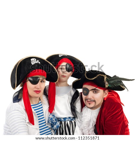 cute little boy and his parents in the pirate costumes - stock photo