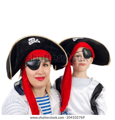 cute little boy and his pretty young mother in the pirate costumes - stock photo