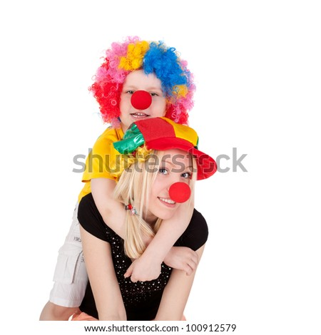 cute little boy and his young beautiful mother dressed as the clowns