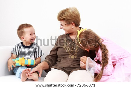 Cute little boy and little girl happy with grandmother - stock photo