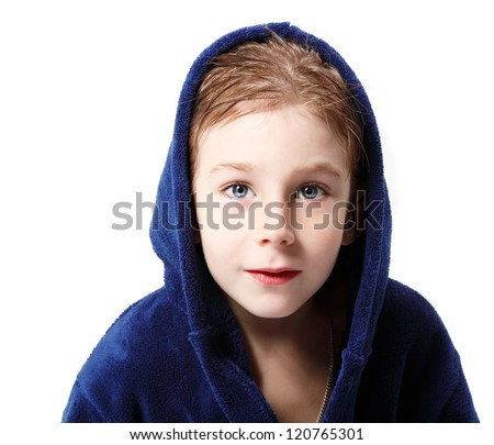 cute little boy beautiful after shower in blue bathrobe with wet hair