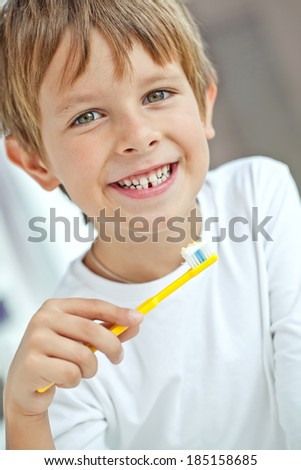 Cute little boy brushing teeth - stock photo