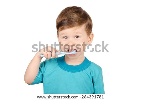 Cute little boy brushing teeth isolated on white background