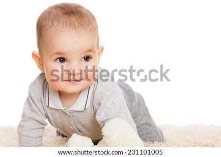 Cute little boy crawling on the carpet. Child seven months. - stock photo