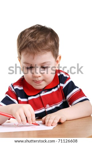 cute little boy drawing isolated on white