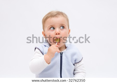 cute, little, boy eating a lollipop