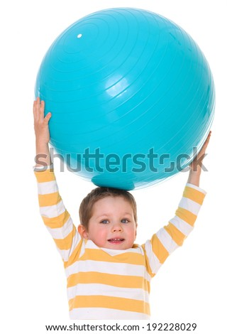 Cute little boy holding head over to the big blue ball, isolated on white background - stock photo