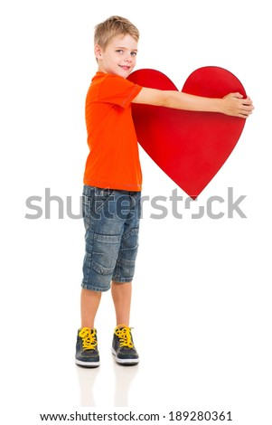cute little boy holding red heart isolated on white - stock photo