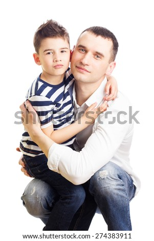 Cute little boy hugging his dad's neck - stock photo
