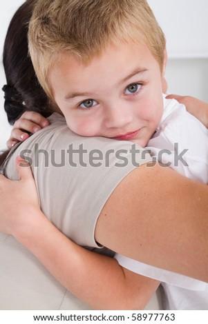 cute little boy hugging mother - stock photo