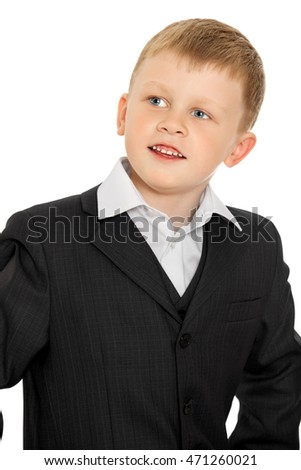 Cute little boy in a suit and white shirt. Smiles turned sideways to the camera-Isolated on white background
