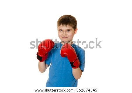 cute little boy in boxing gloves on a white background