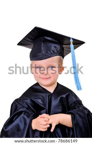 Cute little boy in graduation dress - stock photo