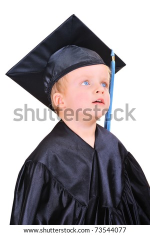 Cute little boy in graduation gown thinking - stock photo