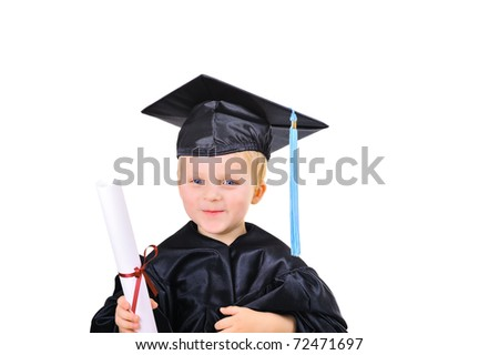 Cute little boy in graduation gown with diploma