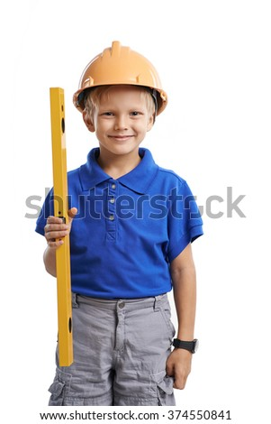 Cute little boy in hardhat holding a level