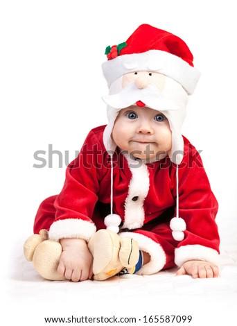 Cute little boy in Santa costume over white  - stock photo