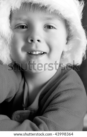Cute Little boy in Santa hat, black and white - stock photo