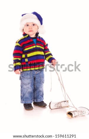 Cute little boy in Santa's hat with figure skates isolated - stock photo