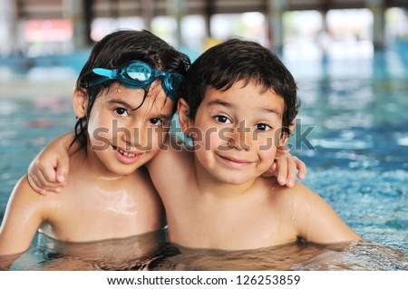Cute little boy in swimming pool - stock photo
