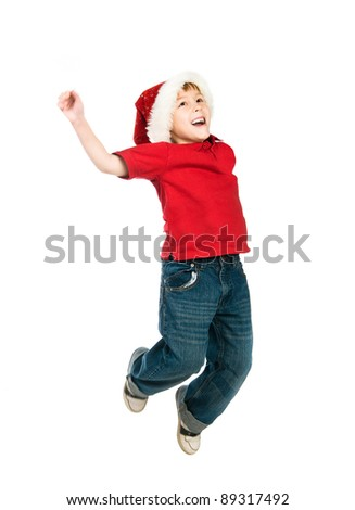 Cute little boy in the santa claus hat - stock photo