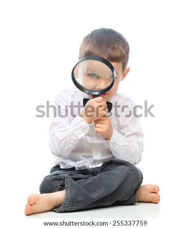 Cute little boy is looking through magnifier, isolated over white - stock photo