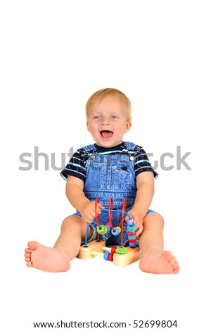 Cute little boy is playing with a toy - stock photo