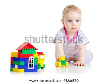 Cute little boy is playing with colorful car isolated on white - stock photo