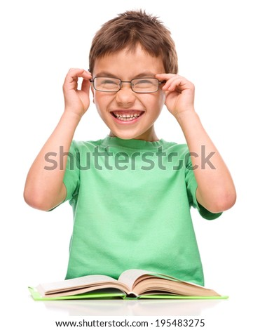 Cute little boy is wearing glasses, isolated over white - stock photo