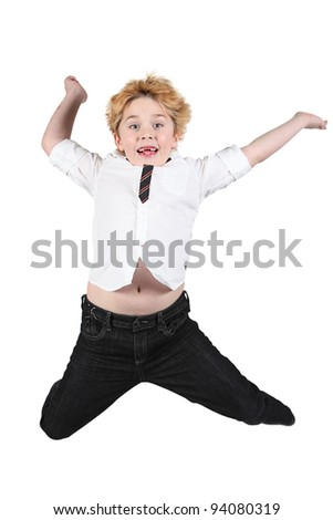 Cute little boy jumping in air on white background