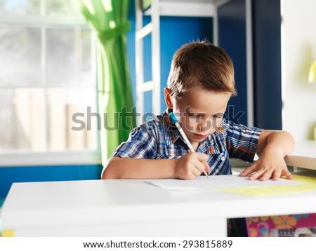 cute little boy learning alphabet - stock photo