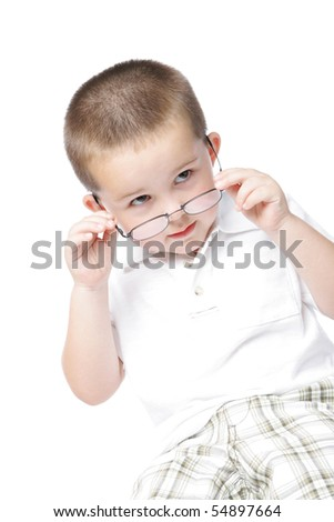 Cute little boy looking over the rim of his glasses - stock photo