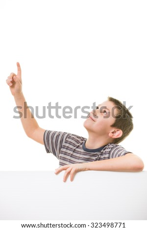 Cute little boy looking up towards blank/empty space (room for your graphics) - stock photo