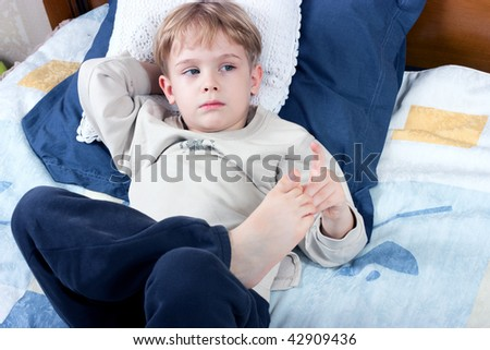cute little boy lying on the bed