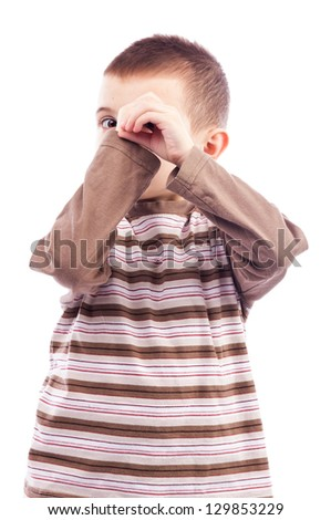 Cute little boy  making an imaginary binocular with hands isolated on white background - stock photo