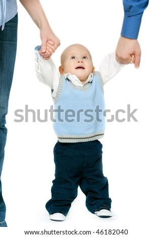 cute little boy making his first steps with parents - isolated on white background - stock photo