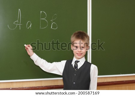 cute little boy near the blackboard - stock photo