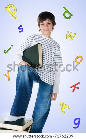 Cute little boy near the stack of big books on white background - stock photo