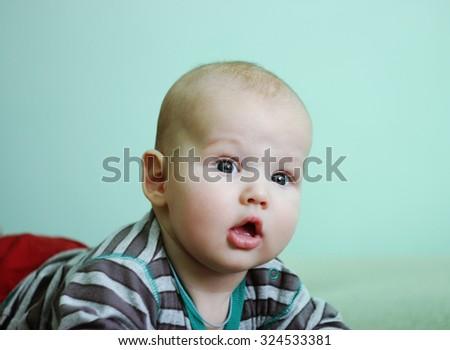 cute little boy on green background - stock photo
